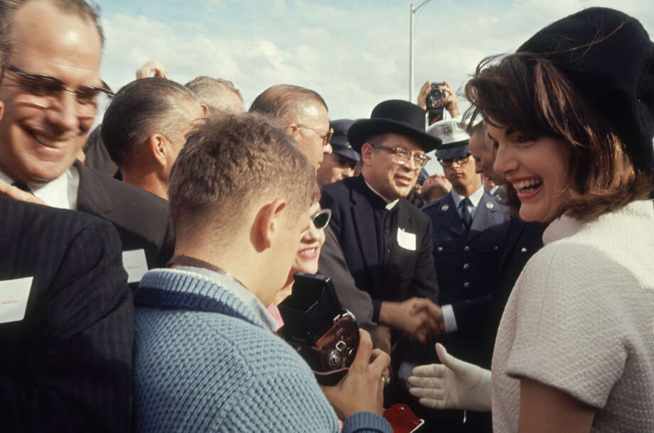 Photographers take photos of Jacqueline Kennedy at San Antonio International Airport on Nov. 21, 1963. Photo: Art Rickerby, Time & Life Pictures Via Getty Images / Time & Life Pictures