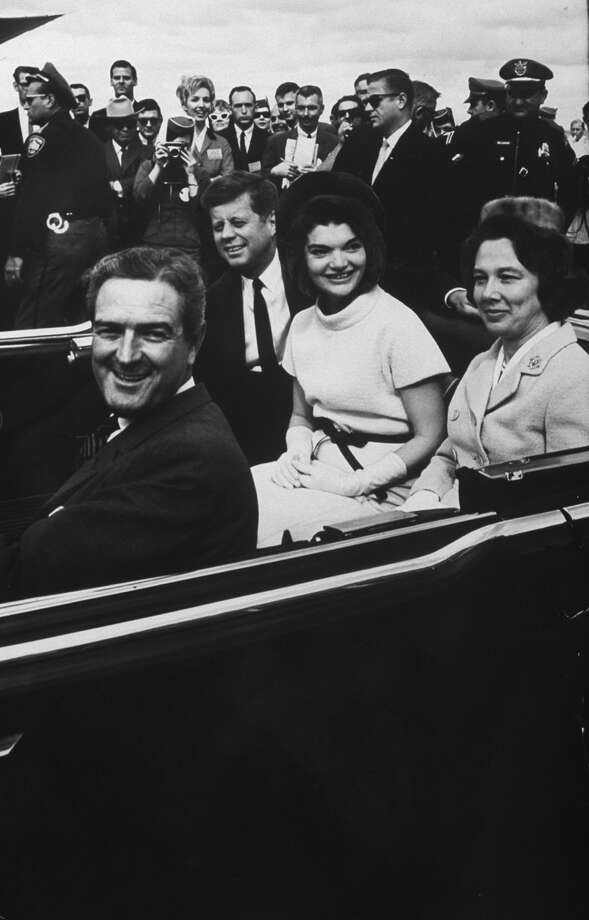 Texas Gov. John B. Connally and wife Nellie ride in a San Antonio motorcade with President John F. Kennedy and wife Jacqueline on Nov. 21, 1963. Photo: Art Rickerby, Time & Life Pictures Via Getty Images / Time Life Pictures