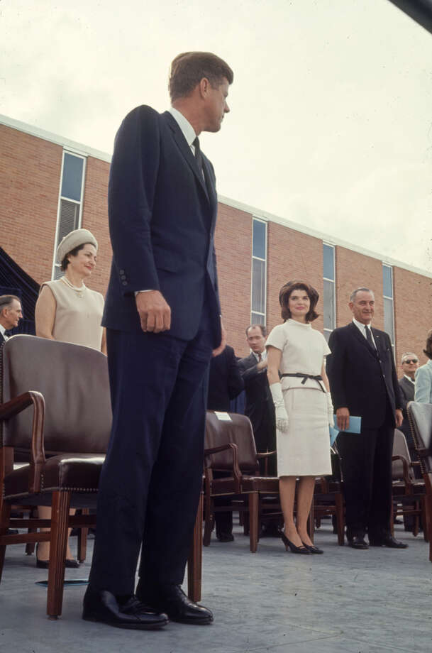 President John F. Kennedy looks over at his wife Jacqueline, who is standing next to Vice President Lyndon Johnson, during the Aerospace Medical Health Center dedication ceremony at Brooks AFB in San Antonio on Nov. 21, 1963. Photo: Art Rickerby, Time & Life Pictures Via Getty Images / Time & Life Pictures