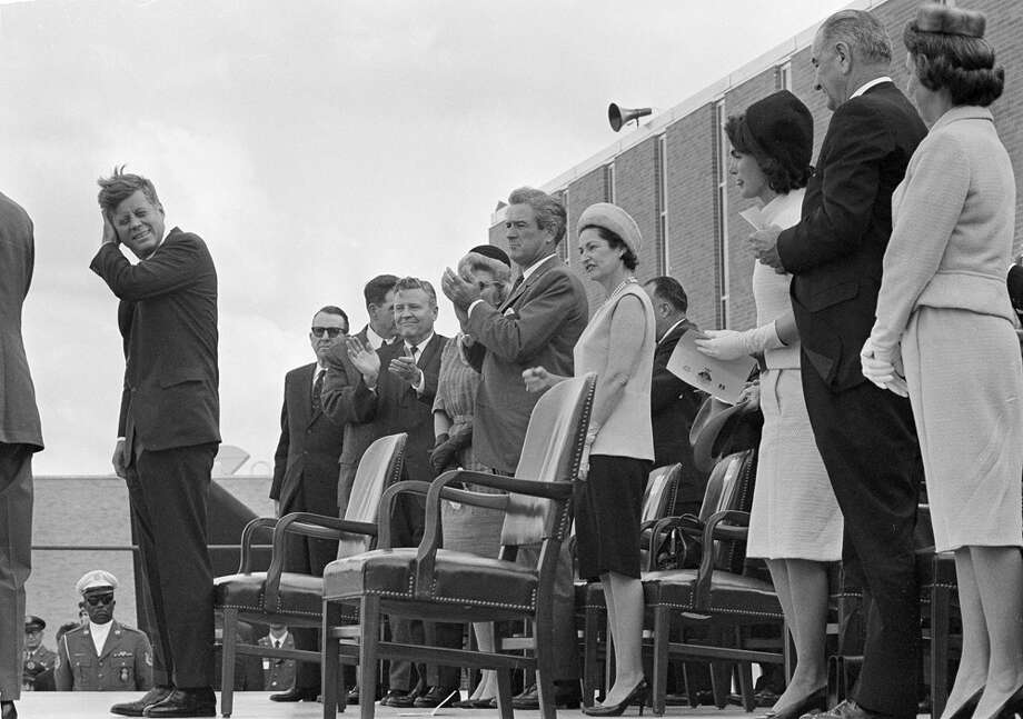 President John F. Kennedy attends the dedication ceremony of the Aerospace Medical Center at Brooks Air Force Base in San Antonio, Nov. 21, 1963. Vice President Lyndon B. Johnson, first lady Jacqueline Kennedy, Johnson's wife Lady Bird Johnson, Texas Gov. John Connally and his wife Nellie Connally, along with other dignitaries applaud at seats behind rostrum. Photo: Associated Press File Photo / AP