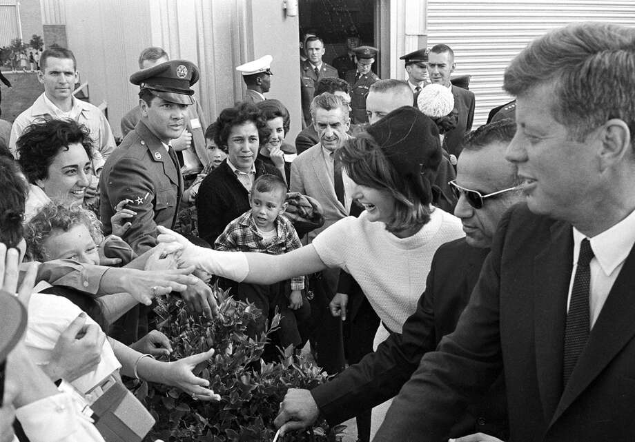 Eager hands reach out to shake hands with President John F. Kennedy and first lady Jacqueline Kennedy as they visited San Antonio, where the president dedicated the Aerospace Medical Center at Brooks Air Force Base, Nov. 21, 1963. Photo: Ted Powers, Associated Press File Photo / AP