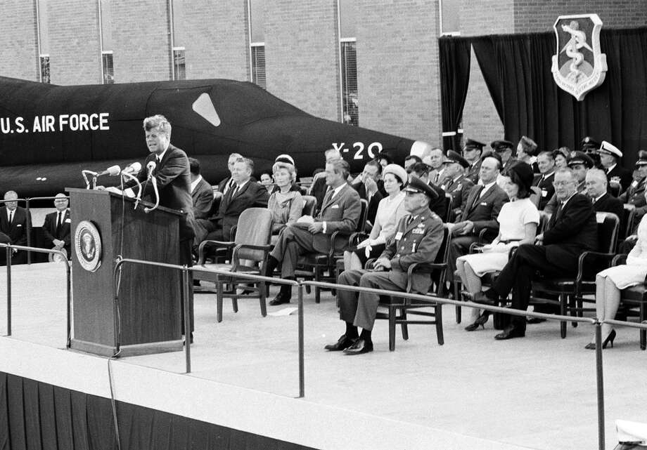 President John F. Kennedy speaks at dedication ceremonies of the Aerospace Medical Center at Brooks Air Force Base, San Antonio, Nov. 21, 1963. First lady Jacqueline Kennedy, Vice President Lyndon B. Johnson, his wife Lady Bird Johnson, and other dignitaries occupy seats behind the speaker's rostrum. Photo: Ted Powers, Associated Press File Photo / AP
