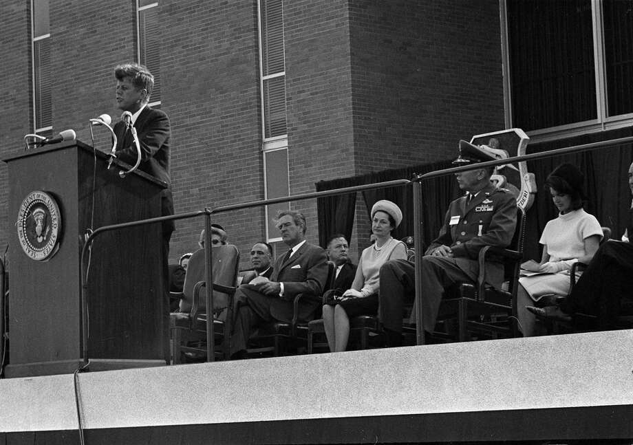 President John F. Kennedy speaks at dedication ceremonies of the Aerospace Medical Center at Brooks Air Force  Base, San Antonio, Nov. 21, 1963. From left, seated behind the rostrum are Texas Gov. John Connally, Lady Bird Johnson, wife of the vice president, an unidentified officer, and first lady Jacqueline Kennedy. Photo: Associated Press File Photo / AP
