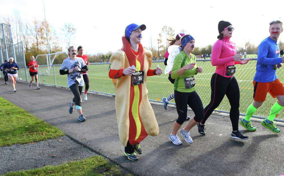 Competitors run during the Mustache Dache 5K on Saturday, November 16, 2013 at Maguson Park in Seattle. During the race competitors ran with mustaches. More than 2,000 people participated in the run that helped raise money for Movember, an effort to support men's health.