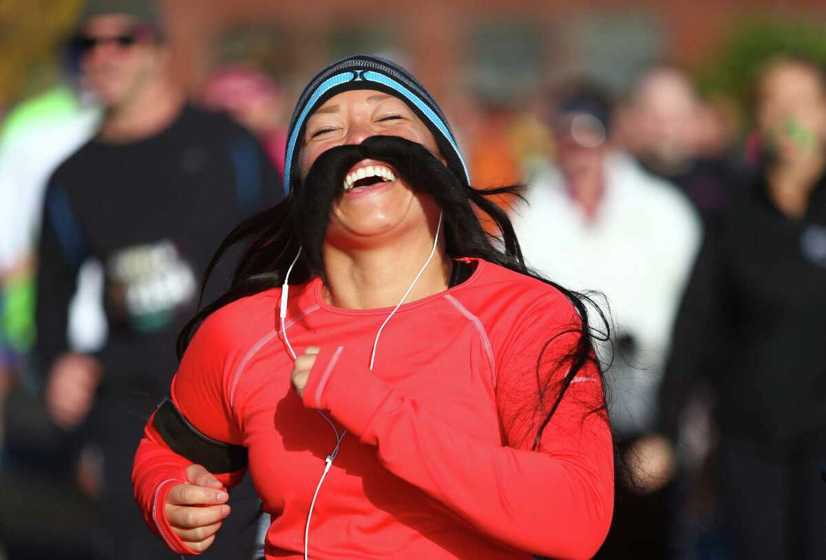 A competitor runs during the Mustache Dache 5K on Saturday, November 16, 2013 at Maguson Park in Seattle. During the race competitors ran with mustaches. More than 2,000 people participated in the run that helped raise money for Movember, an effort to support men's health.