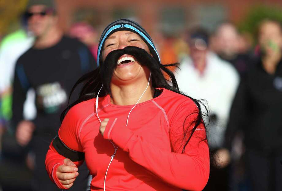 A competitor runs during the Mustache Dache 5K on Saturday, November 16, 2013 at Maguson Park in Seattle. During the race competitors ran with mustaches. More than 2,000 people participated in the run that helped raise money for Movember, an effort to support men's health. Photo: JOSHUA TRUJILLO, SEATTLEPI.COM / SEATTLEPI.COM
