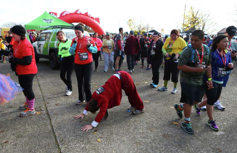 A competitor stretches during the Mustache Dache 5K on Saturday, November 16, 2013 at Maguson Park in Seattle. During the race competitors ran with mustaches. More than 2,000 people participated in the run that helped raise money for Movember, an effort to support men's health. Photo: JOSHUA TRUJILLO, SEATTLEPI.COM / SEATTLEPI.COM