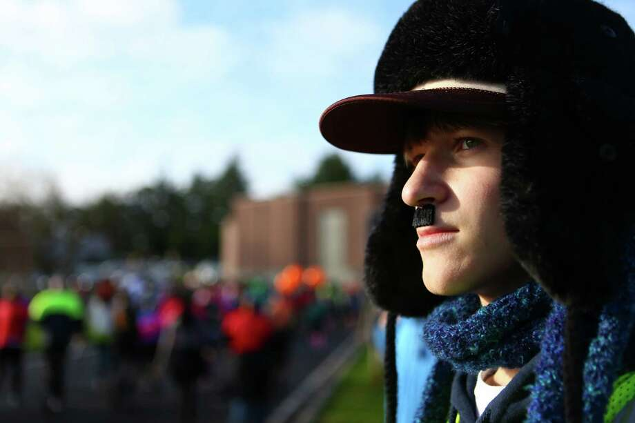 A man watches runners during the Mustache Dache 5K on Saturday, November 16, 2013 at Maguson Park in Seattle. During the race competitors ran with mustaches. More than 2,000 people participated in the run that helped raise money for Movember, an effort to support men's health. Photo: JOSHUA TRUJILLO, SEATTLEPI.COM / SEATTLEPI.COM