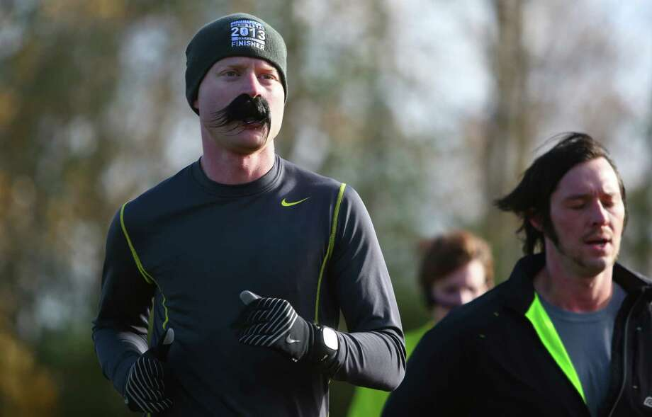 Competitors run during the Mustache Dache 5K on Saturday, November 16, 2013 at Maguson Park in Seattle. During the race competitors ran with mustaches. More than 2,000 people participated in the run that helped raise money for Movember, an effort to support men's health. Photo: JOSHUA TRUJILLO, SEATTLEPI.COM / SEATTLEPI.COM