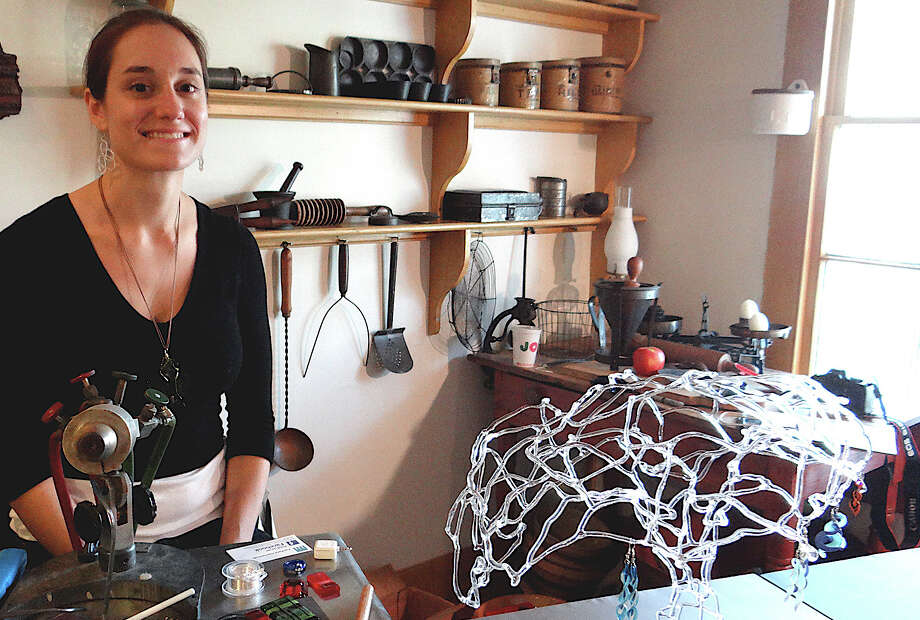 Stefania Urist displays handmade glass jewelry at the Westport Historical Society's annual Gem of a Craft Show. Photo: Mike Lauterborn / Westport News contributed