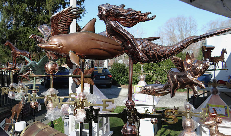 Copper weather vanes by Rolling Thunder Home Accents shine in the sun late Saturday afternoon at the Westport Historical Society's annual crafts show. Photo: Mike Lauterborn / Westport News contributed