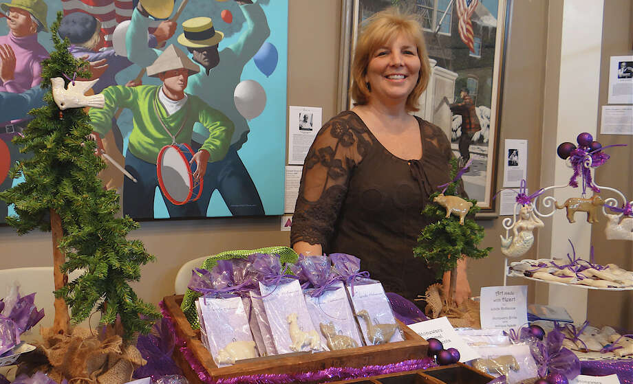 Linda Dohanos, granddaughter of artist Stevan Dohanos, shows her stoneware animal ornaments at the Westport Historical Society's annual Gem of a Craft Show. Photo: Mike Lauterborn / Westport News contributed