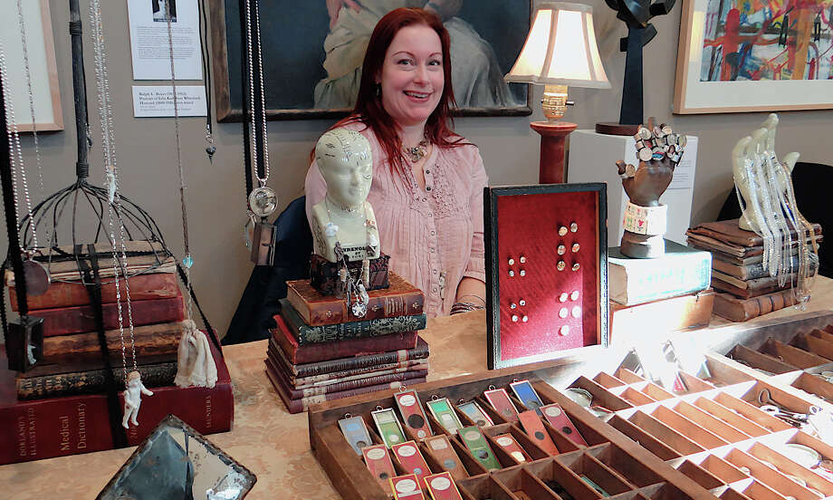 Amy Nyitray exhibits jewelry made from antique ephemera at the Westport Historical Society's annual crafts show. Photo: Mike Lauterborn / Westport News contributed