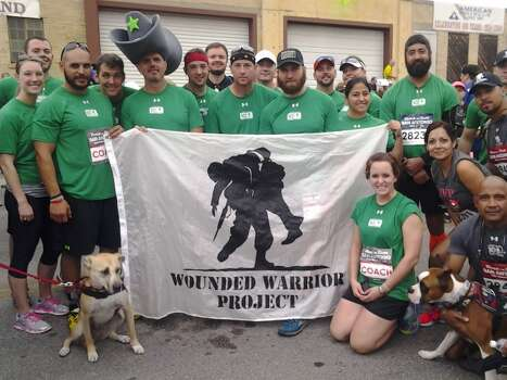 A team and their pups run for Wounded Warrior Project. Photo: Stefanie Arias/Express-News