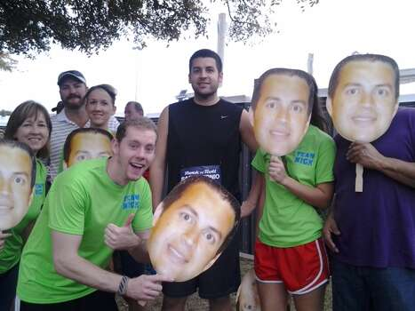 Nick Guerrero (center) celebrates his 27th birthday by running his first ever half marathon. Family and friends cheer him on with Team Nick shirts and huge photo cutouts of his face. Photo: Stefanie Arias/Express-News