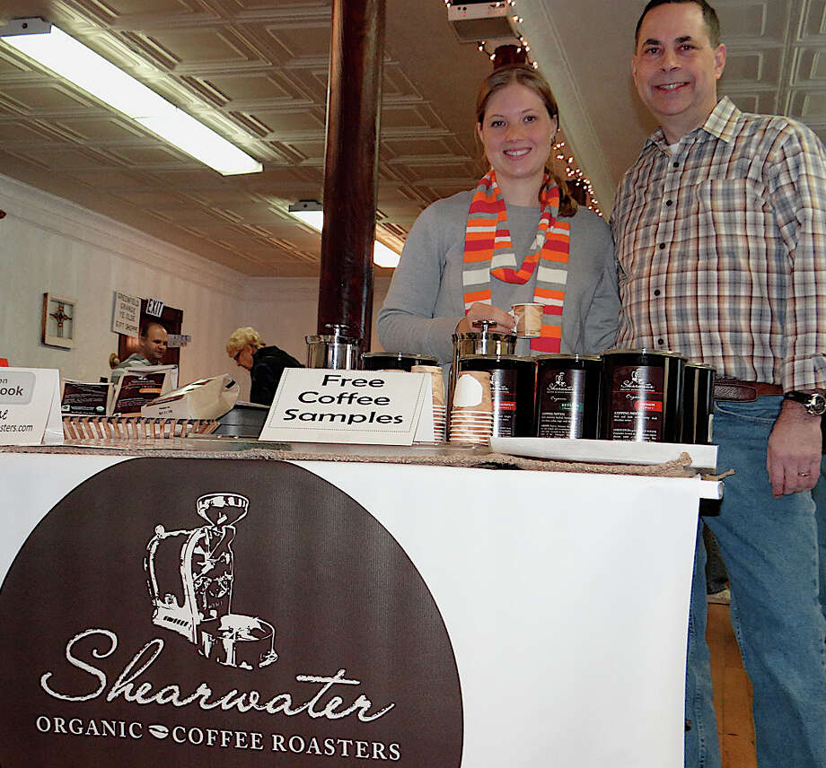 Leah and Ed Freedman offer samples of their Shearwater Organic Coffee Roasters at the Greenfield Hill Grange's farm market Saturday. Photo: Mike Lauterborn / Fairfield Citizen contributed