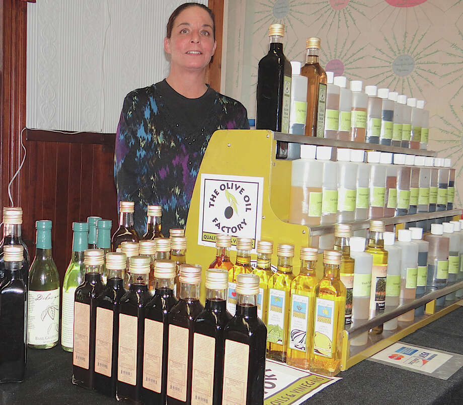 Lisa Morgan of the Olive Oil Factory sold her specialty olive oils at Saturday's winter farm market at the Greenfield Hill Grange. Photo: Mike Lauterborn / Fairfield Citizen contributed