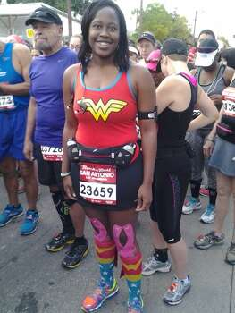 Nicole Washington is ready to run her third half marathon as her favorite superhero, Wonder Woman. It's the first time she's dressed up for a race. Photo: Stefanie Arias/Express-News