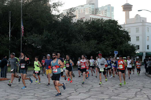 "Participants run through Alamo Plaza during the Rock ""n"" Roll San Antonio Marathon, Sunday, Nov. 17, 2013. Approximately 25,000 runners were expected. Photo: JERRY LARA, San Antonio Express-News / © 2013 San Antonio Express-News"