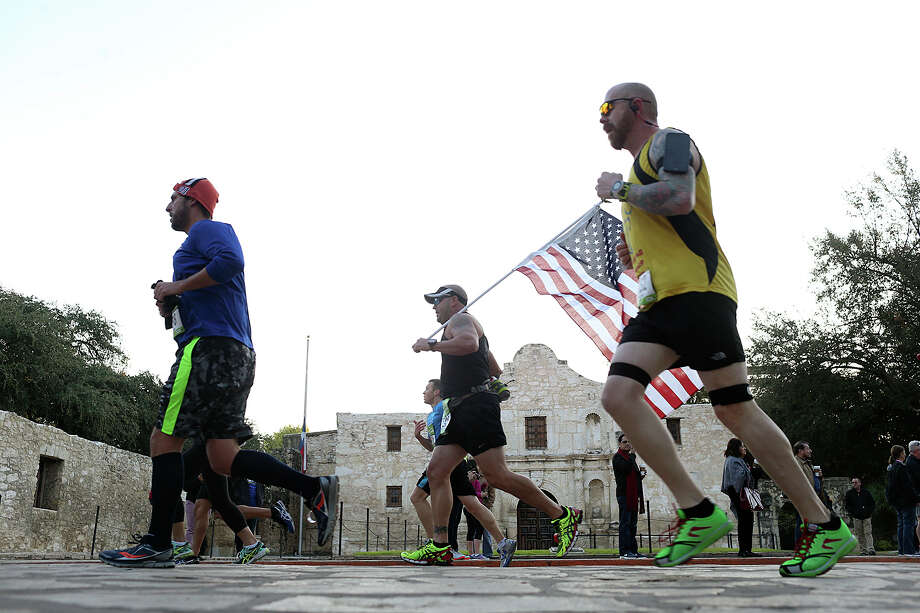 "Participants run through Alamo Plaza during the Rock ""n"" Roll San Antonio Marathon, Sunday, Nov. 17, 2013. Approximately 25,000 runners were expected. Photo: JERRY LARA, San Antonio Express-News / © 2015 San Antonio Express-News"