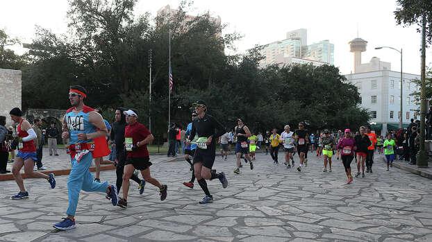 "The elite runners go through Alamo Plaza during the Rock ""n"" Roll San Antonio Marathon, Sunday, Nov. 17, 2013. Photo: JERRY LARA, San Antonio Express-News / © 2013 San Antonio Express-News"