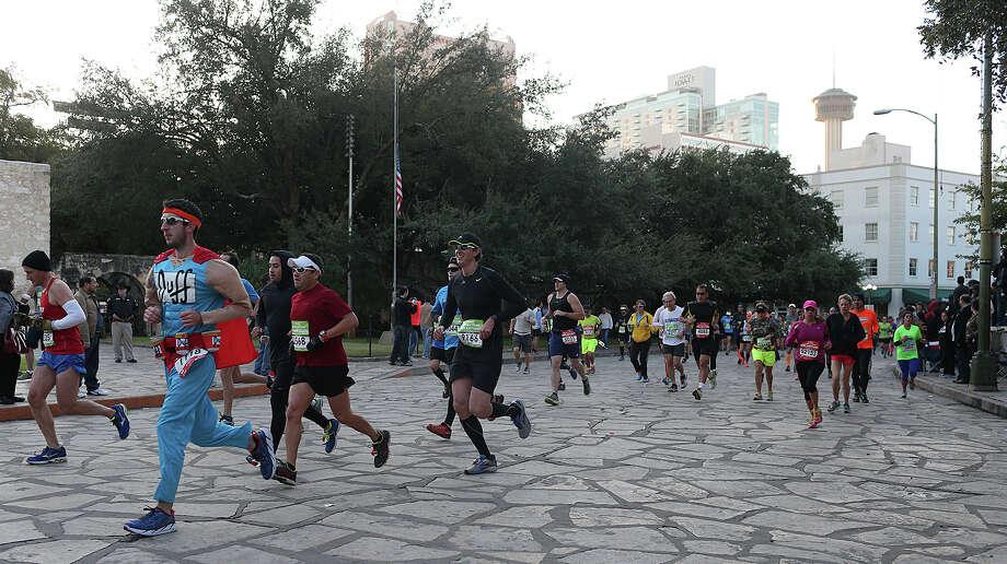 "The elite runners go through Alamo Plaza during the Rock ""n"" Roll San Antonio Marathon, Sunday, Nov. 17, 2013. Photo: JERRY LARA, San Antonio Express-News / © 2015 San Antonio Express-News"