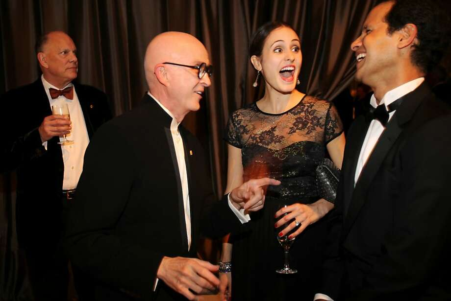 Melanie Hamrick, center, and Jose Carreno, right, laugh as they meet Orlando Diaz-Azcuy , second from left, with Diaz-Azcuy's partner, John Capo standing at left, during the cocktail reception for the Artistic Director Jose Manuel Carreno with Ballet San Jose as part of a gala evening and performance November 16, 2013 at the San Jose Center for Performing Arts in San Jose, Calif. Photo: Leah Millis, The Chronicle