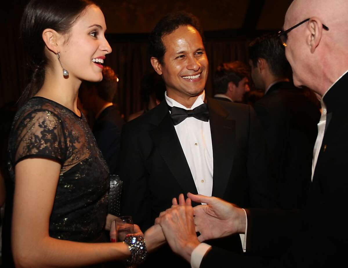 Melanie Hamrick, left, and Jose Carreno, center meet Orlando Diaz-Azcuy during the cocktail reception for the Artistic Director Jose Manuel Carreno with Ballet San Jose as part of a gala evening and performance November 16, 2013 at the San Jose Center for Performing Arts in San Jose, Calif.