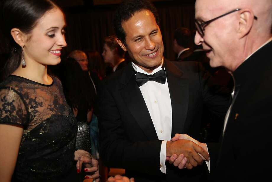 Melanie Hamrick, left, and Jose Carreno, center meet Orlando Diaz-Azcuy during the cocktail reception for the Artistic Director Jose Manuel Carreno with Ballet San Jose as part of a gala evening and performance November 16, 2013 at the San Jose Center for Performing Arts in San Jose, Calif. Photo: Leah Millis, The Chronicle