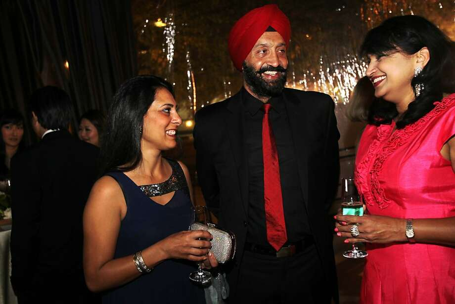 From left, Pavan and Pradeep Bakshi chat with Vijaya Aasuri during the cocktail reception for the Artistic Director Jose Manuel Carreno with Ballet San Jose as part of a gala evening and performance November 16, 2013 at the San Jose Center for Performing Arts in San Jose, Calif. Photo: Leah Millis, The Chronicle