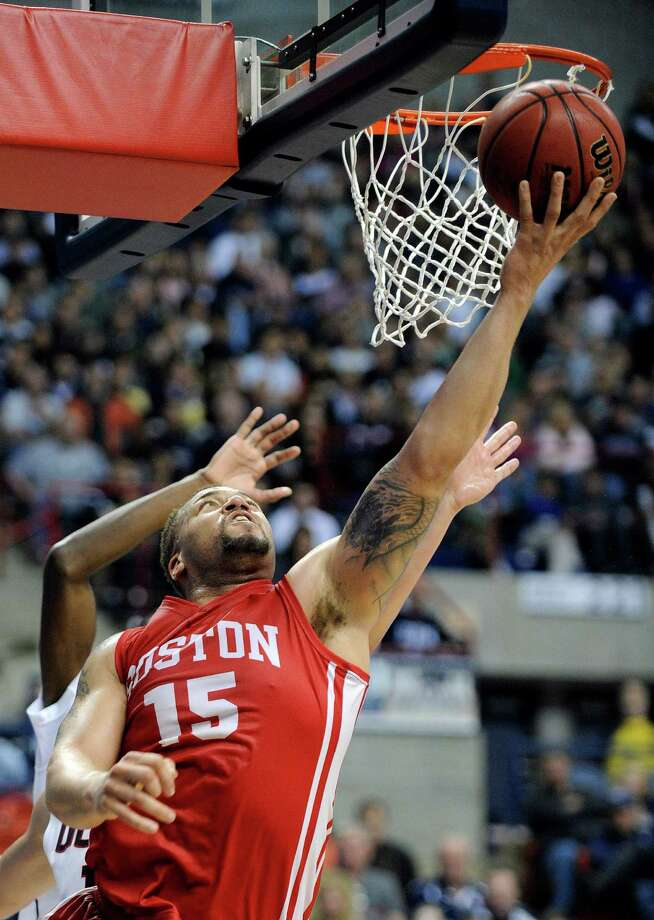 Boston University's Dom Morris (15) drives to the basket during the first half of an NCAA college basketball game against Connecticut in Storrs, Conn., on Sunday, Nov. 17, 2013. Photo: Fred Beckham, AP / Associated Press