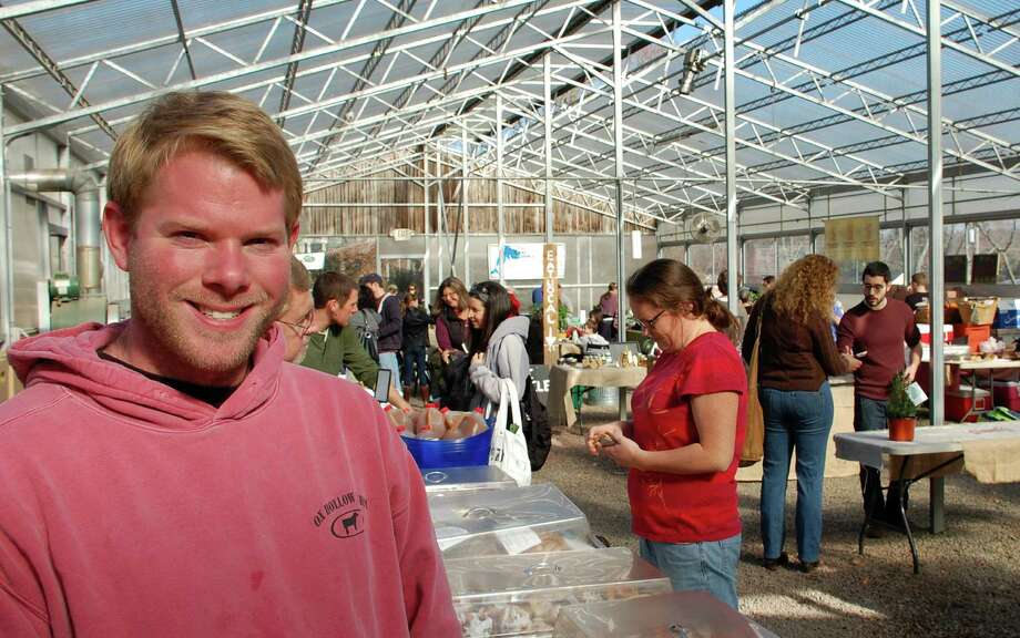 John Filch of Ox Hollow Farm in Roxbury at Saturday's Westport Winter Farmers Market, which opened for the season at Gilbertie's Herb Gardens on Sylvan Lane. Photo: Jarret Liotta / Westport News contributed