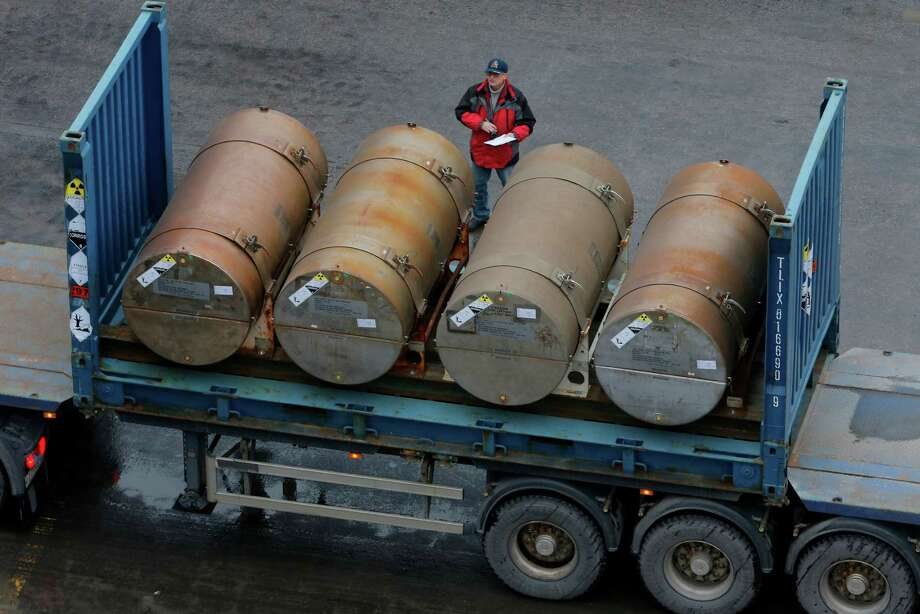 A truck carries containers with low-enriched uranium to be used as fuel for nuclear reactors,  on a port in St. Petersburg, Russia, Thursday, Nov. 14, 2013. A 20-year program to convert highly enriched uranium from dismantled Russian nuclear weapons into fuel for U.S. power plants has ended, with the final shipment loaded onto a vessel in St. Petersburg's port on Thursday. The U.S. Energy Department described the program, commonly known as Megatons to Megawatts, as one of the most successful nuclear nonproliferation partnerships ever undertaken. Photo: Dmitry Lovetsky, AP / AP2013