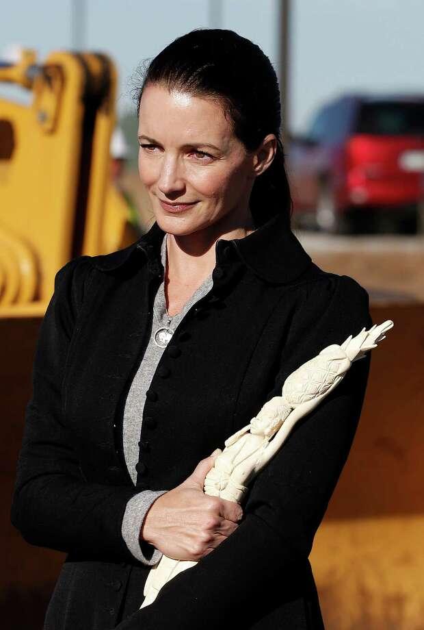 Actress Kristin Davis carries confiscated ivory to be destroyed during an event at the National Wildlife Property Repository, at Rocky Mountain Arsenal National Wildlife Refuge, in Commerce City, Colo., Thursday Nov. 14, 2013. Six tons of banned elephant ivory was destroyed Thursday after being accumulated over the past 25 years, seized during undercover investigations of organized smuggling operations or confiscated at the U.S. border. Photo: Brennan Linsley, AP / AP2013