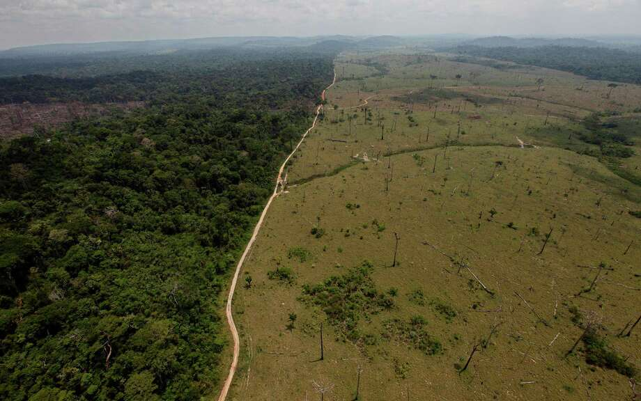 This Sept. 15, 2009 file photo shows a deforested area near Novo Progresso in Brazil's northern state of Para. Brazil's government says destruction of its Amazon rainforest has jumped by 28 percent. The sharp jump in deforestation came in the August 2012 through July 2013 period, the time when Brazil measures the annual destruction of the forest. Photo: Andre Penner/AP, AP / A2011
