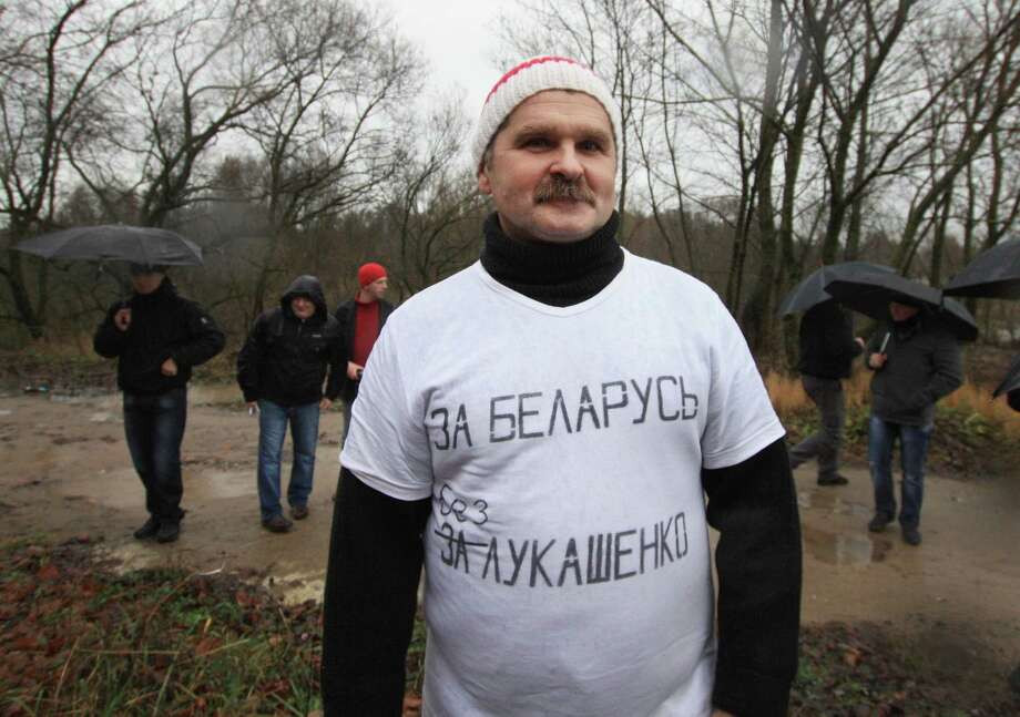 In this photo taken Sunday, Nov. 10, 2013, Belarusian opposition activist Leonid Smovzh wears a T-shirt with a sign reading  �For Belarus without Lukashenko� during a protest in Minsk, Belarus. Leonid Smovzh, a 53-year-old railroad engineer, arrested for wearing a T-shirt criticizing authoritarian President Alexander Lukashenko, has been freed after five days in jail. Photo: Uladz Hrydzin, AP / AP2013