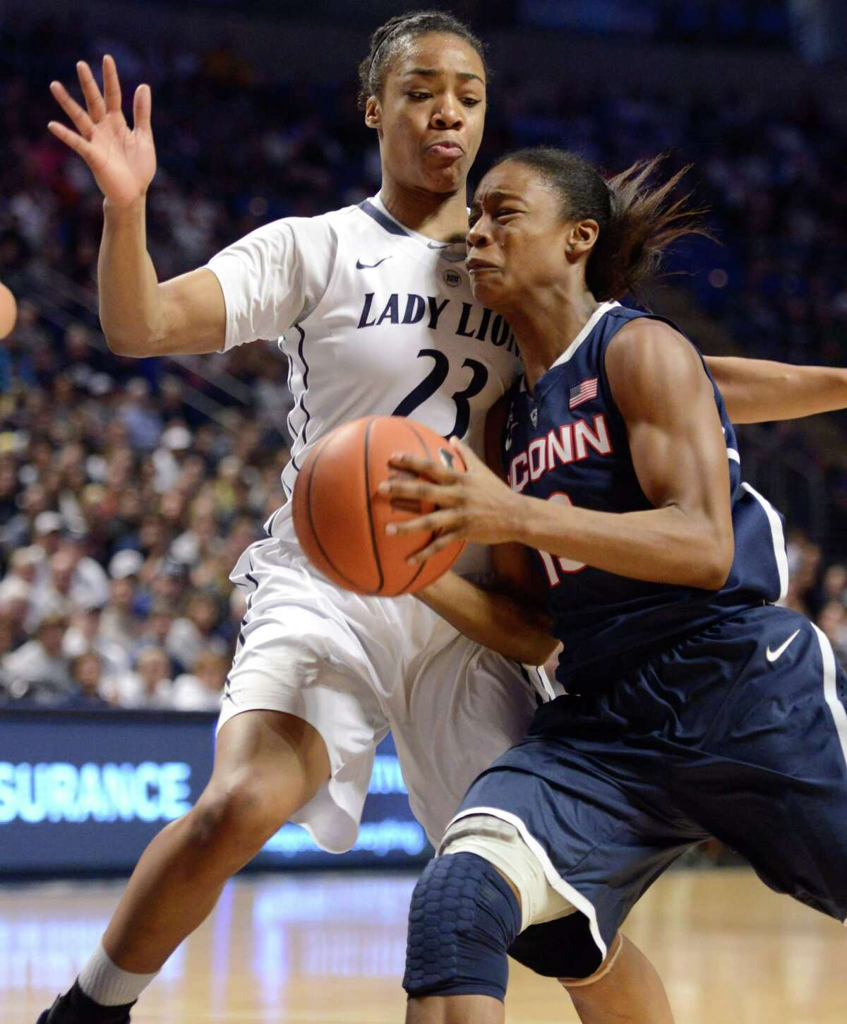 Connecticut's Brianna Banks, right, tries to elude Penn State's Ariel Edwards (23) during the first half of an NCAA college basketball game, Sunday, Nov. 17, 2013, in State College, Pa.