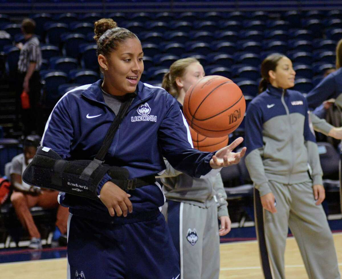 Sidelined by an injury, Connecticut's Kaleena Mosqueda-Lewis (23) catches balls for teammates before an NCAA college basketball game against Penn State, Sunday, Nov. 17, 2013, in State College, Pa.