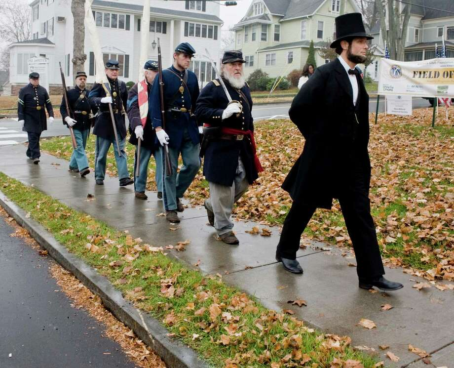 The 11th Regiment, Connecticut Volunteer Infantry Co. A Color Guard along with Abraham Lincoln impersonator Howard Wright march into position at the New Milford Historical Society for the celebration of the Underground Railroad and 150th anniversary of the Civil War. Sunday, Nov. 17, 2013 Photo: Scott Mullin / The News-Times Freelance