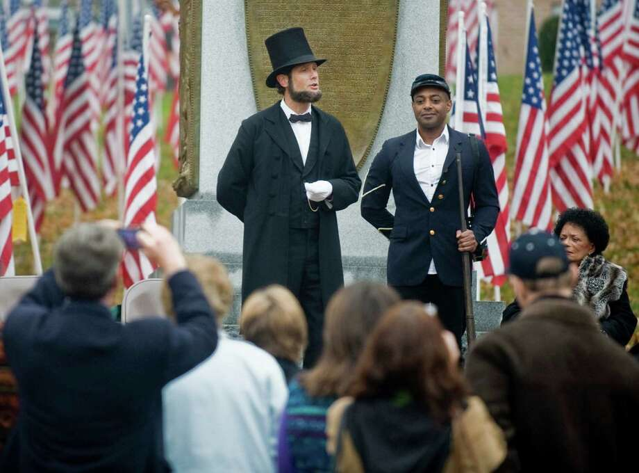Abraham Lincoln impersonator Howard Wright recites the Gettysburg Address with 29th Regiment soldier Ray Dunbar Smith at attention during the celebration of the Underground Railroad and the 150th anniversary of the Civil War, at the New Milford Historical Society. Sunday, Nov. 17, 2013 Photo: Scott Mullin / The News-Times Freelance