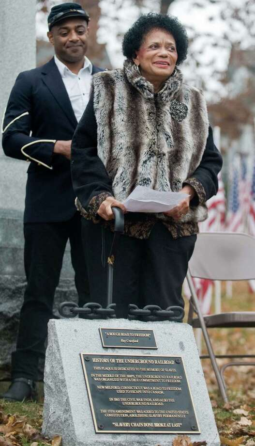 29th Regiment Honor Guard soldier Ray Dunbar Smith stands behind his mother Frances Smith of New Milford, geneologist and author with remarks during the celebration of the Underground Railroad and the 150th anniversary of the Civil War, at the New Milford Historical Society. Sunday, Nov. 17, 2013 Photo: Scott Mullin / The News-Times Freelance