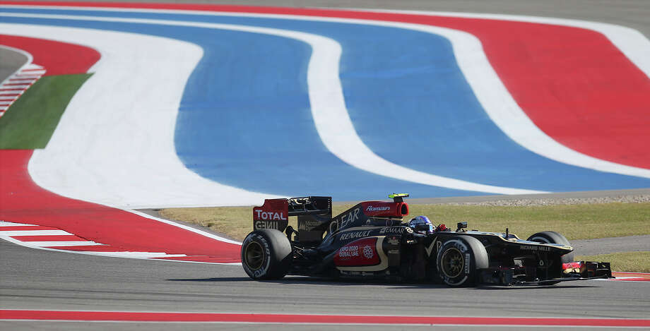 Lotus F1 driver Romain Grosjean clears Turn 19 at the Formula One United States Grand Prix afternoon practice session at the Circuit of the Americas near Austin, Texas on Friday, Nov. 15, 2013. Photo: Kin Man Hui, San Antonio Express-News / ©2013 San Antonio Express-News
