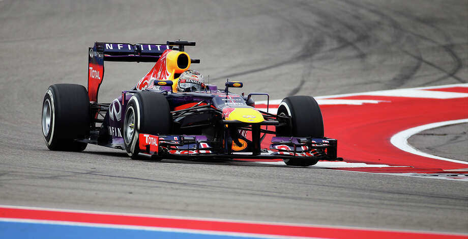 Current World Champion Sebastian Vettel rounds a corner during the Formula One United States Grand Prix morning practice session at the Circuit of the Americas near Austin, Texas on Saturday, Nov. 16, 2013. Photo: Kin Man Hui, San Antonio Express-News / ©2013 San Antonio Express-News