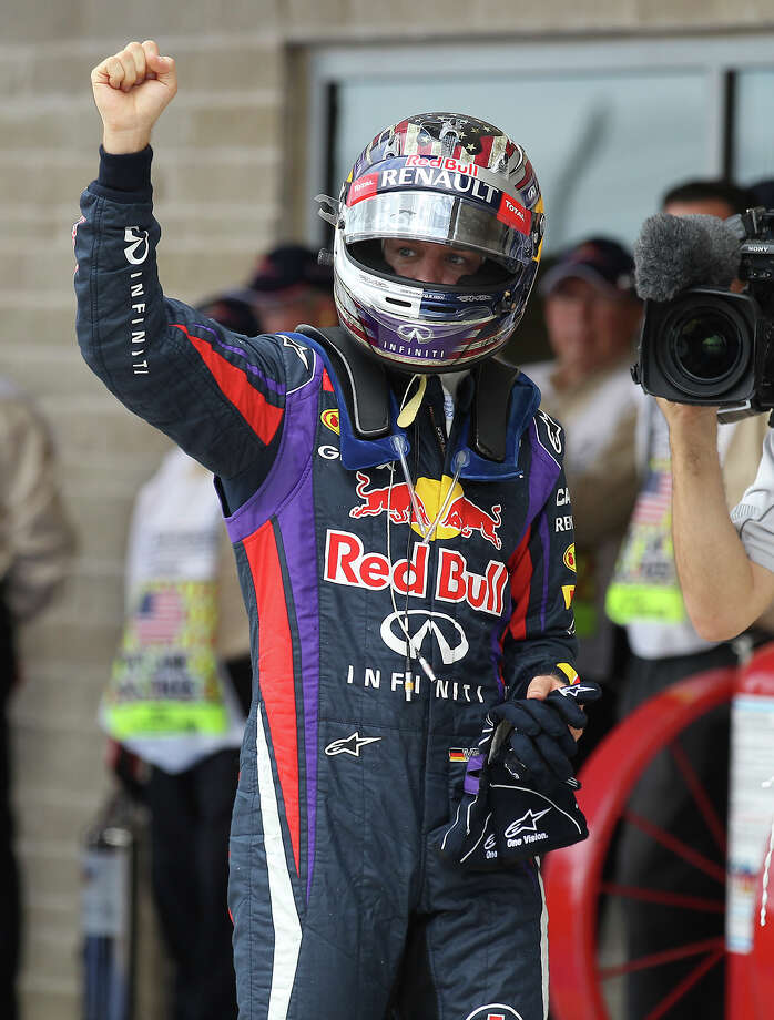 Current World Champion Sebastian Vettel clenches his first in reaction after capturing the pole position just edging out teammate Mark Webber for Sunday's Formula One United States Grand Prix at the Circuit of the Americas near Austin, Texas on Saturday, Nov. 16, 2013. The top three qualifiers are in order: Vettel, Webber and Lotus F1 driver Romain Grosjean. Photo: Kin Man Hui, San Antonio Express-News / ©2013 San Antonio Express-News
