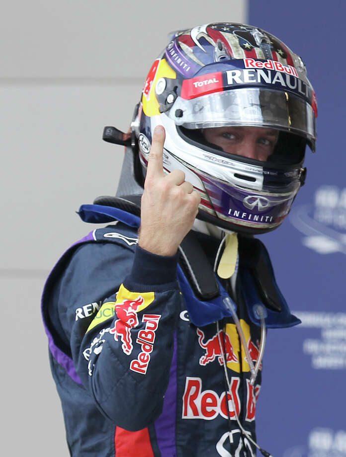 Current World Champion Sebastian Vettel gestures the No.1 sign after capturing the pole position just edging out teammate Mark Webber for Sunday's Formula One United States Grand Prix at the Circuit of the Americas near Austin, Texas on Saturday, Nov. 16, 2013. The top three qualifiers are in order: Vettel, Webber and Lotus F1 driver Romain Grosjean. Photo: Kin Man Hui, San Antonio Express-News / ©2013 San Antonio Express-News