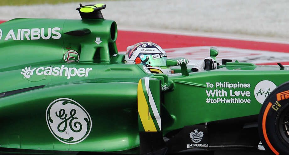 The Caterham F1 car driven by Giedo Van Der Garde is seen with a message of support for victims in the Philippines from Super Typhoon Haiyan by sponsor AirBus during the Formula One United States Grand Prix morning practice session at the Circuit of the Americas near Austin, Texas on Saturday, Nov. 16, 2013. Photo: Kin Man Hui, San Antonio Express-News / ©2013 San Antonio Express-News