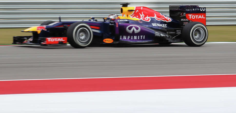 Current World Champion Sebastian Vettel attains the pole position during the qualifying session at the Formula One United States Grand Prix at the Circuit of the Americas near Austin, Texas on Saturday, Nov. 16, 2013. The top three qualifiers are in order: Current World Champion Sebastian Vettel, Vettel's teammate Mark Webber and Lotus F1 driver Romain Grosjean. Photo: Kin Man Hui, San Antonio Express-News / ©2013 San Antonio Express-News