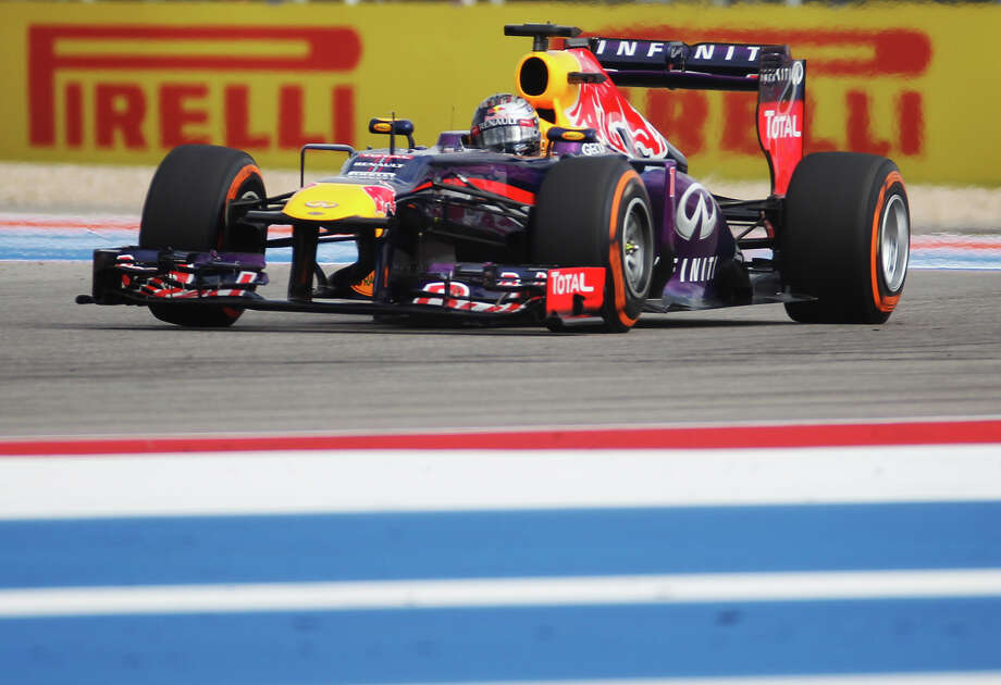 Current World Champion Sebastian Vettel makes a run to qualify for the pole position at the Formula One United States Grand Prix at the Circuit of the Americas near Austin, Texas on Saturday, Nov. 16, 2013. The top three qualifiers are in order: Vettel, Vettel's teammate Mark Webber and Lotus F1 driver Romain Grosjean. Photo: Kin Man Hui, San Antonio Express-News / ©2013 San Antonio Express-News