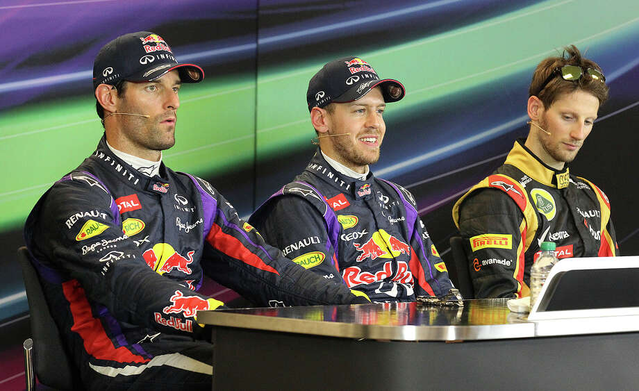 Drivers Mark Webber (from left), Sebastian Vettel and Romain Grosjean attend a press conference at the qualifying session at the Formula One United States Grand Prix at the Circuit of the Americas near Austin, Texas on Saturday, Nov. 16, 2013. The top three qualifiers are in order: Vettel, Webber and Grosjean. Photo: Kin Man Hui, San Antonio Express-News / ©2013 San Antonio Express-News