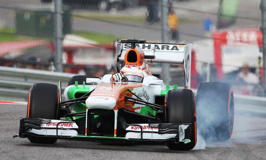Smoke emanates from the Sahara Force India car driven by Paul Di Resta during the Formula One United States Grand Prix morning practice session at the Circuit of the Americas near Austin, Texas on Saturday, Nov. 16, 2013. Photo: Kin Man Hui, San Antonio Express-News / ©2013 San Antonio Express-News